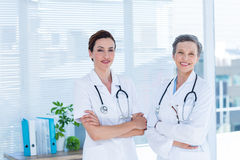 Portrait of smiling medical colleagues with arms crossed Stock Images