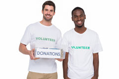 Portrait of smiling men participating at charity Stock Photos