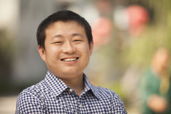 Portrait of Smiling Mid Adult Man in Nanluoguxiang, Beijing, China Royalty Free Stock Photography