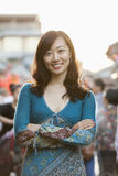 Portrait Of Smiling Mid Adult Woman With Arms Crossed In Houhai, Beijing Stock Photo