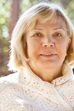 Portrait of a smiling middle age woman Royalty Free Stock Image