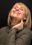 Portrait of a smiling middle aged caucasian woman. Royalty Free Stock Images