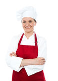 Portrait of smiling middle aged cook in uniform Stock Photos