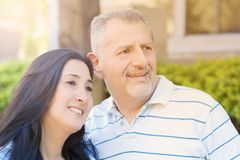 Portrait of smiling middle-aged couple looking forward Royalty Free Stock Photography