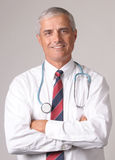 Portrait of Smiling Middle aged Doctor Royalty Free Stock Images