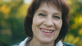 Portrait of smiling middle aged woman stock video