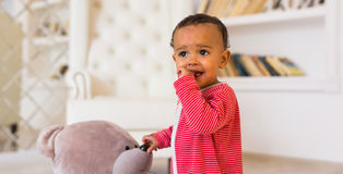 Portrait of smiling mixed race baby at home.  Royalty Free Stock Photos