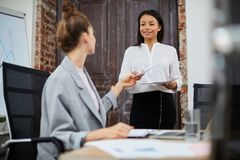 Boss and Secretary in Office royalty free stock photography
