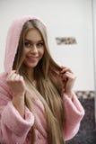 Portrait of smiling model dressed in bathrobe Royalty Free Stock Image
