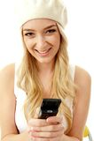 Portrait of smiling model holding mobile Stock Images