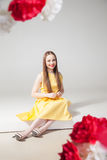 Portrait of smiling model in yellow dress with red lips Stock Photo