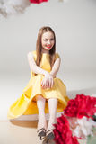 Portrait of smiling model in yellow dress with red lips Royalty Free Stock Images