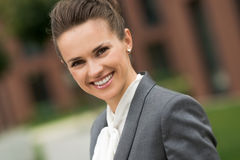 Portrait of smiling modern business woman near office building Stock Images