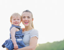 Portrait of smiling mom and baby Royalty Free Stock Images