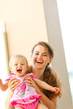 Portrait of smiling mother and baby Royalty Free Stock Images