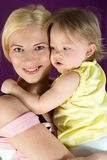 Portrait of smiling mother with baby. Daughter hugging her mother stock photography