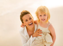 Portrait of smiling mother and baby girl Royalty Free Stock Photos