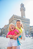 Portrait of smiling mother and baby girl in florence, italy Stock Photography