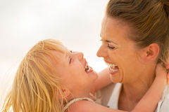 Portrait of smiling mother and baby girl hugging Royalty Free Stock Photo