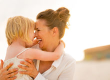 Portrait of smiling mother and baby girl hugging Royalty Free Stock Photography