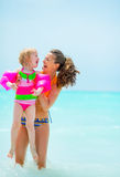 Portrait of smiling mother and baby girl in sea Stock Photography