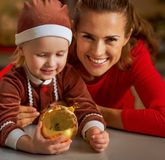 Mother and baby holding christmas ball Royalty Free Stock Images