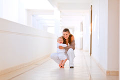 Portrait of smiling mother with cute baby Stock Image