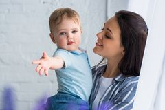 Portrait of smiling mother and cute baby boy. At home royalty free stock photos