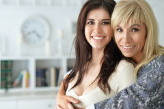 Portrait of smiling mother and daughter. Close up Royalty Free Stock Photos