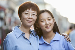 Portrait Of Smiling Mother And Daughter In Houhai, Beijing stock photo