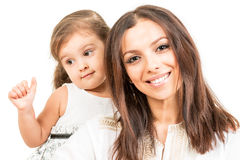 Portrait of smiling  mother with daughter   isolated Royalty Free Stock Photography