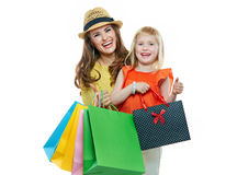Portrait of smiling mother and daughter with shopping bags Royalty Free Stock Photo