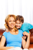 Portrait of smiling mother and son at home Stock Image
