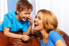 Portrait of smiling mother and son at home Stock Photo
