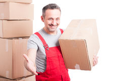 Portrait of smiling mover man offering hand shake Royalty Free Stock Image