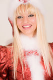 Portrait of smiling mrs. Santa. In red hat stock images