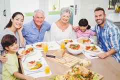 Portrait of smiling multi generation family with arm around Royalty Free Stock Image