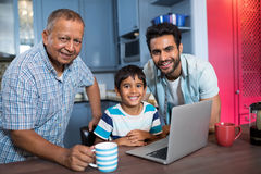 Portrait of smiling multi generation family. At home royalty free stock images