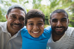 Portrait of smiling multi-generation family. At park stock images