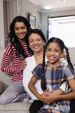 Portrait of smiling multi-generation family in row. At home stock photography