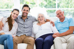 Portrait of smiling multi-generation family sitting on sofa Royalty Free Stock Images
