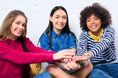 portrait of smiling multicultural students holding royalty free stock photography