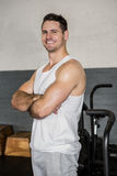 Portrait of a smiling muscular man with arms crossed Stock Photography