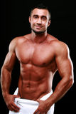Portrait of a smiling muscular man Royalty Free Stock Photos