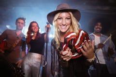 Portrait of smiling musician performing at nighclub Stock Image