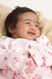 Portrait of a Smiling Newborn Baby Girl Stock Images