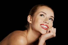 Portrait of smiling nude woman on dark background Royalty Free Stock Photo