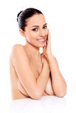 Portrait of smiling nude woman  on white background. Royalty Free Stock Images