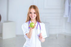 Portrait of a smiling nurse in front Royalty Free Stock Photography