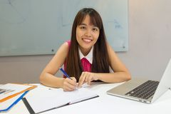 Portrait of smiling office lady working Stock Photography